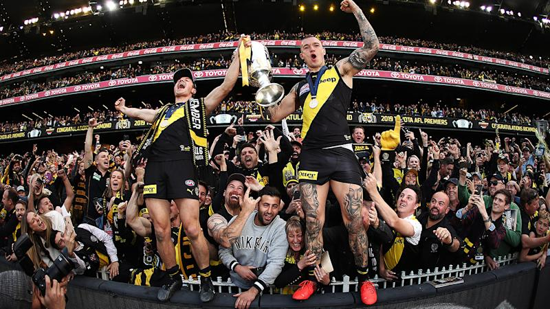 Richmond players, pictured here celebrating their 2019 grand final victory at the MCG.