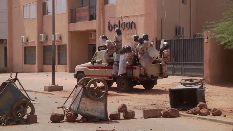 FILE PHOTO: Video grab of riot policemen driving towards protesters at a makeshift checkpoint in Niamey, Niger