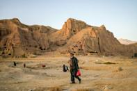 Several hundred Bamiyan families live in caves that were carved into sandstone cliffs by Buddhist monks in the fifth century (AFP/Bulent KILIC)