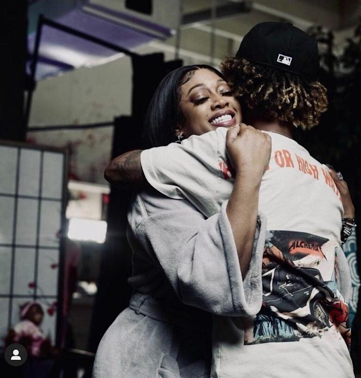 Trina hugs fiancé Raymond Taylor, a Miami-based rapper, in a photo shared to Instagram.