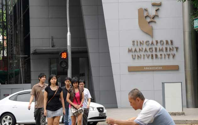 Many new jobs in Singapore do not require formal higher education, says our blogger. (Yahoo! photo)