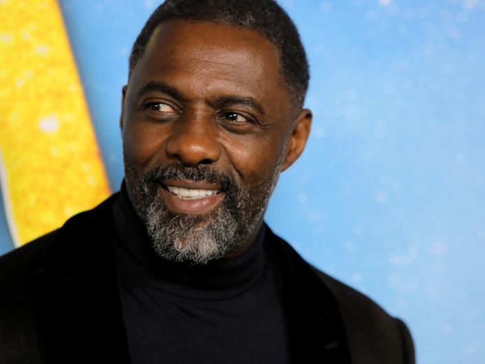 """FILE PHOTO: Actor Idris Elba arrives for the world premiere of the movie """"Cats"""" in Manhattan, New York, U.S., December 16, 2019. REUTERS/Andrew Kelly"""