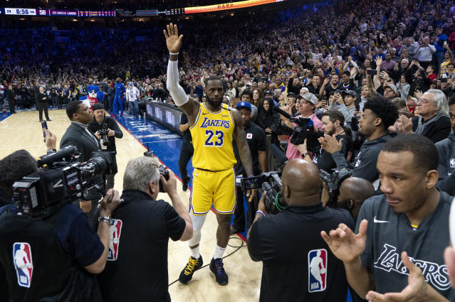 Los Angeles Lakers' LeBron James (23) reacts after moving to No. 3 on the NBA's career scoring list during the second half of a basketball game against the Philadelphia 76ers, Saturday, Jan. 25, 2020, in Philadelphia. (AP Photo/Chris Szagola)