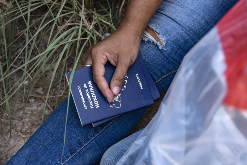 An illegal immigrant holds the passports for her and her daughter