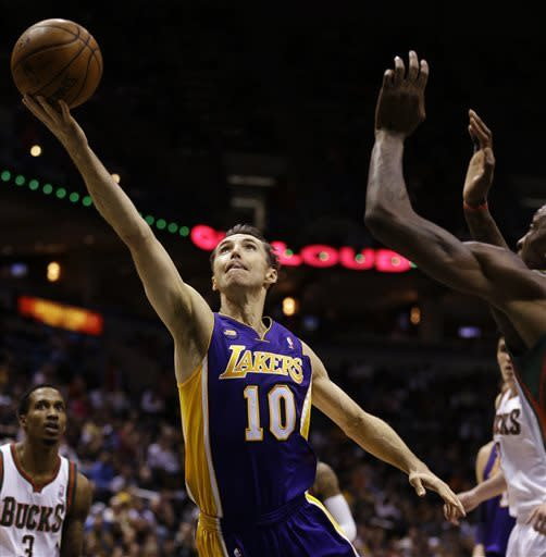 Los Angeles Lakers' Steve Nash(10) drives to the basket against the Milwaukee Bucks during the first half of an NBA basketball game, Thursday, March 28, 2013, in Milwaukee. (AP Photo/Jeffrey Phelps)