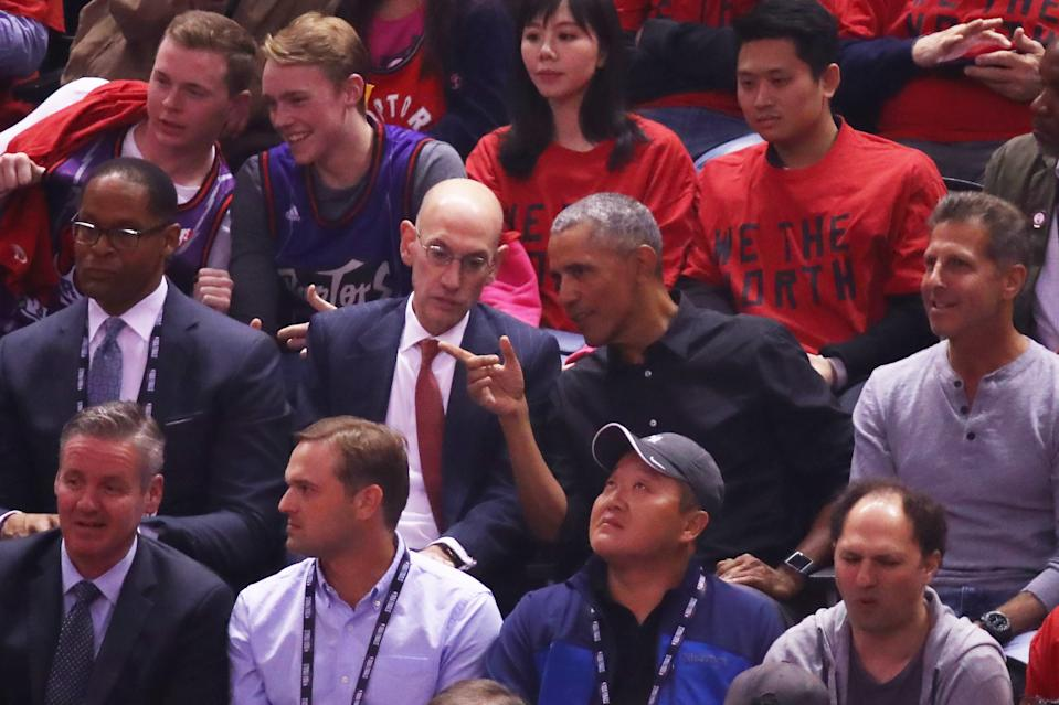 NBA Commissioner Adam Silver and former President of the United States, Barack Obama speak in the first half during Game Two of the 2019 NBA Finals between the Golden State Warriors and the Toronto Raptors at Scotiabank Arena on June 02, 2019 in Toronto, Canada.  NOTE TO USER: User expressly acknowledges and agrees that, by downloading and or using this photograph, User is consenting to the terms and conditions of the Getty Images License Agreement. (Photo by Gregory Shamus/Getty Images)