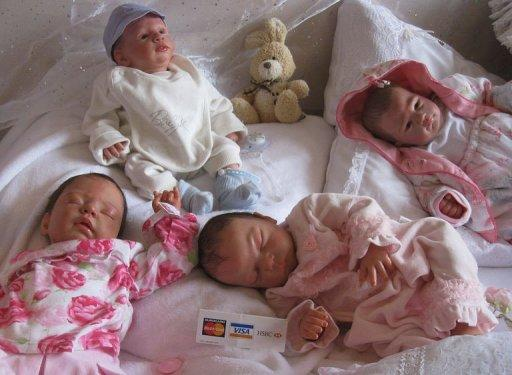 'Reborn babies', dolls which are made to look just like real babies, are displayed at the reborn babies fair in Brentwood, east of London, in February 2011. Weighing five kilos, with perfectly combed hair and her eyes closed in sleep, Abby looks like a baby girl. But she is a doll, adopted by a grieving mother to help come to terms with the loss of a child