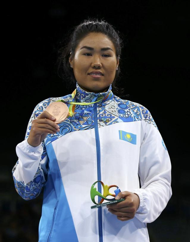 2016 Rio Olympics - Boxing - Victory Ceremony - Women's Middle (75kg) Victory Ceremony - Riocentro - Pavilion 6 - Rio de Janeiro, Brazil - 21/08/2016. Bronze medallist Dariga Shakimova (KAZ) of Kazakhstan poses with her medal. REUTERS/Peter Cziborra FOR EDITORIAL USE ONLY. NOT FOR SALE FOR MARKETING OR ADVERTISING CAMPAIGNS.