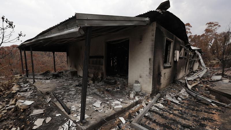 The home of Justin Kam and Helena Wong barely stands after a fire destroyed the house at Balmoral. Source: AAP