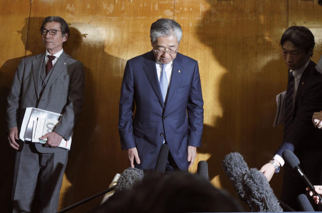 In this Tuesday, March 19, 2019, file photo, International Olympics Committee member and head of the Japanese Olympic Committee Tsunekazu Takeda bows as he speaks after a JOC executive board meeting in Tokyo. Takeda is resigning amid a bribery scandal that investigators suspect helped Tokyo land next year's Olympics. Takeda announced Tuesday he will stand down when his term ends in June, but he denied corruption allegations against him. (AP Photo/Eugene Hoshiko, File)