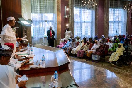 Nigeria's President Muhammadu Buhari speaks during his meeting with some of the newly released Dapchi schoolgirls in Abuja, Nigeria March 23, 2018. Nigeria Presidency/Handout via Reuters