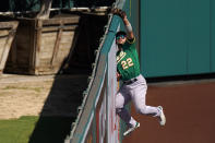 Oakland Athletics center fielder Ramon Laureano makes a catch at the wall on a ball hit by Los Angeles Angels' Brian Goodwin during the seventh inning of a baseball game Wednesday, Aug. 12, 2020, in Anaheim, Calif. (AP Photo/Mark J. Terrill)