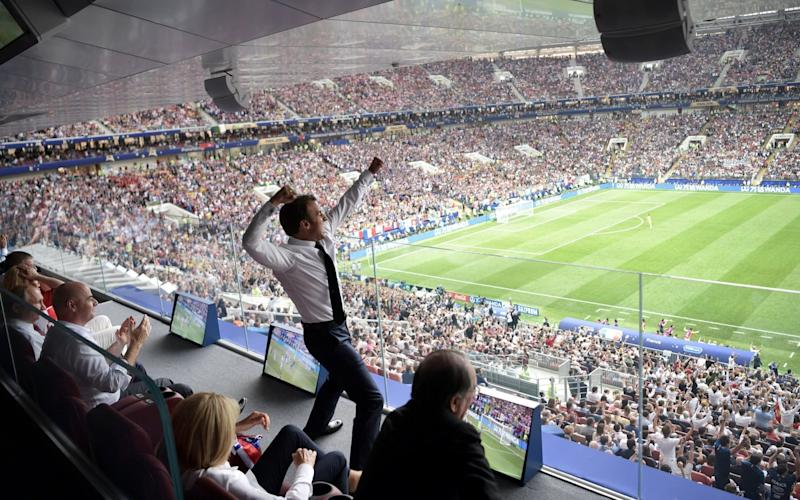 Mr Macron didn't hold back as he watched France lift the trophy - REUTERS
