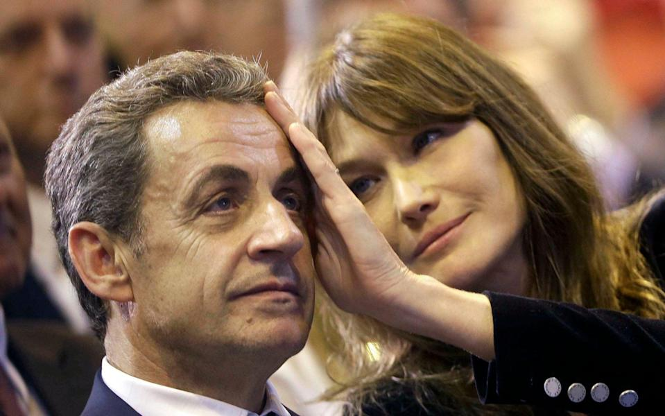 Carla Bruni and her husband Nicolas Sarkozy, who feared Jagger's influence on his wife - AP Photo/Claude Paris