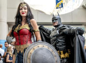 <p>Cosplayers dressed as Wonder Woman and Batman at Comic-Con International on July 18, 2018, in San Diego. (Photo: Christy Radecic/Invision/AP) </p>