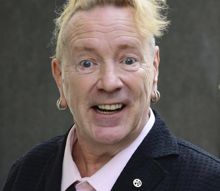 John Lydon, also known as Johnny Rotten, arrives at the Hight Court Rolls Building in London, to give evidence in a hearing between two former Sex Pistols band members and the band frontman over the use of their songs in a television series, Wednesday July 21, 2021. Drummer Paul Cook and the band's former guitarist, Steve Jones, are suing the Pistols' former lead singer to allow their songs to be used in a TV series. (Ian West/PA via AP)