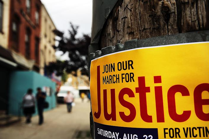 A poster for a protest near where Eric Garner was killed in an encounter with an NYPD officer in July on August 22, 2014 in the borough of Staten Island in New York City (AFP Photo/Spencer Platt)