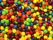 "<p>M&Ms were first <a href=""https://www.history.com/news/the-wartime-origins-of-the-mm#:~:text=M%26Ms%20were%20first%20released%20in,highlights%20in%20their%20long%20history."" rel=""nofollow noopener"" target=""_blank"" data-ylk=""slk:released in 1941"" class=""link rapid-noclick-resp"">released in 1941</a> and were invented by Mars as a <a href=""https://www.history.com/news/the-wartime-origins-of-the-mm#:~:text=M%26Ms%20were%20first%20released%20in,highlights%20in%20their%20long%20history."" rel=""nofollow noopener"" target=""_blank"" data-ylk=""slk:snack for soldiers in World War II"" class=""link rapid-noclick-resp"">snack for soldiers in World War II</a>. The small amount was easy to produce on wartime rations, while the hard candy shell prevented the chocolate from melting in a soldier's bag. </p>"