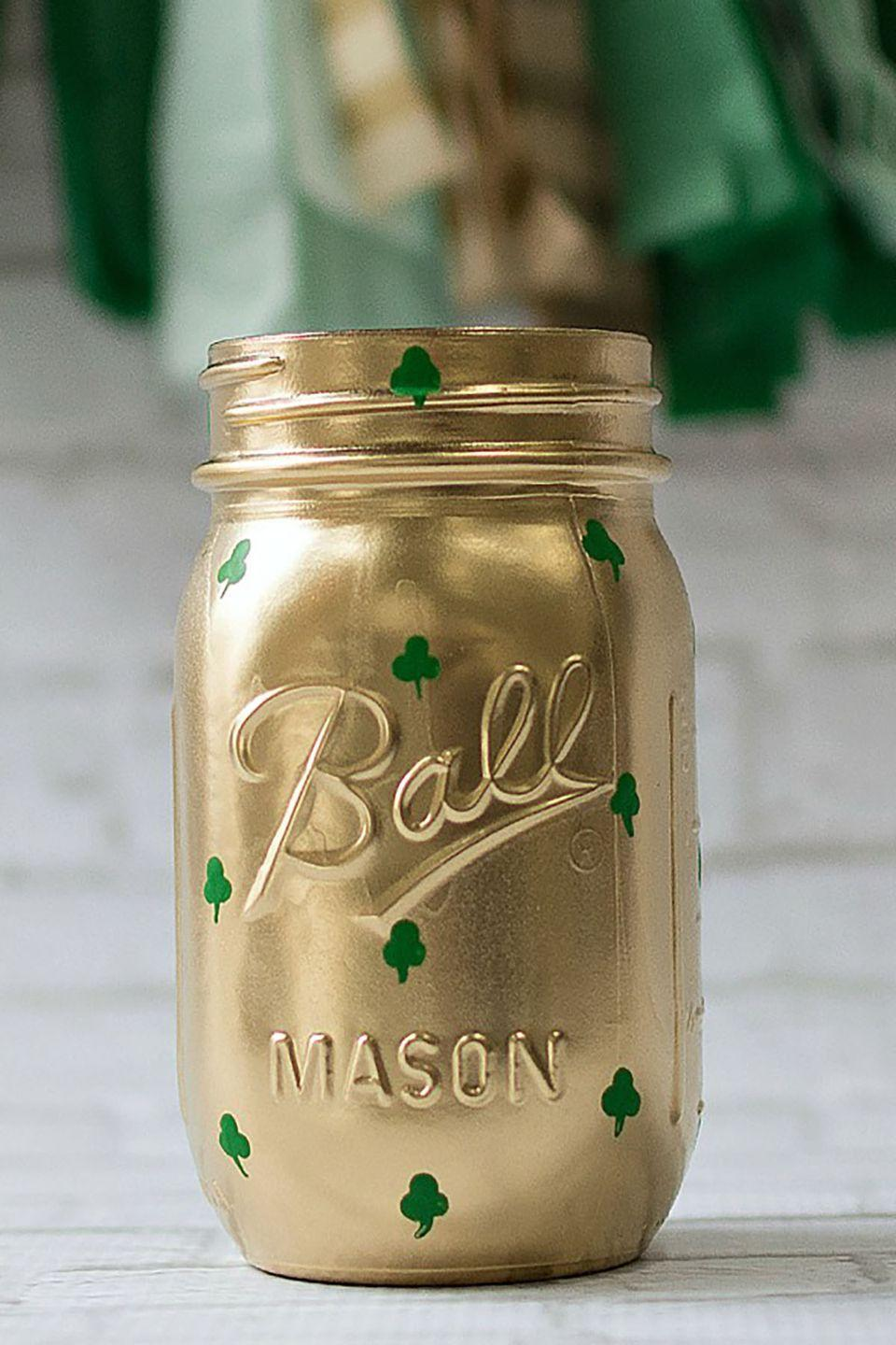 """<p>Throw a few florals (maybe even some bells of Ireland) into a gilded vase stamped with shamrocks for instant St. Patrick's Day decor.</p><p><strong>Get the tutorial at <a href=""""http://masonjarcraftslove.com/shamrock-mason-jars-2/"""" rel=""""nofollow noopener"""" target=""""_blank"""" data-ylk=""""slk:Mason Jar Crafts"""" class=""""link rapid-noclick-resp"""">Mason Jar Crafts</a>.</strong></p><p><a class=""""link rapid-noclick-resp"""" href=""""https://www.amazon.com/Ball-Mason-Jar-16-Clear-Heritage/dp/B0764L6ZR9/ref=sr_1_6?tag=syn-yahoo-20&ascsubtag=%5Bartid%7C10050.g.4036%5Bsrc%7Cyahoo-us"""" rel=""""nofollow noopener"""" target=""""_blank"""" data-ylk=""""slk:SHOP MASON JARS"""">SHOP MASON JARS</a></p>"""