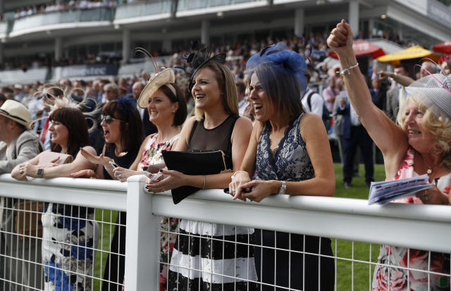 Britain Horse Racing - Derby Festival - Epsom Racecourse - June 2, 2017 Racegoers during the festival Reuters / Peter Nicholls Livepic EDITORIAL USE ONLY.