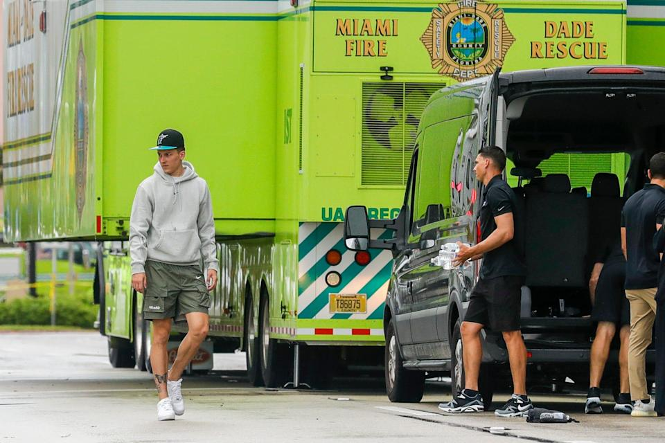 Miami Heat guard Tyler Herro helps rescue personnel deliver donations at the scene of a collapsed building in Surfside, Florida.