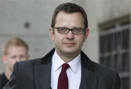 Former News of the World editor Andy Coulson arrives at the Old Bailey courthouse in London November 13, 2013. REUTERS/Neil Hall