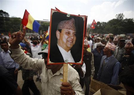 File picture shows a supporter of the Rastriya Prajatantra Party Nepal holds a portrait of former King Gyanendra Shah during a protest rally in Kathmandu