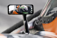 Pato O'Ward, of Mexico, sits in his car during testing at the Indianapolis Motor Speedway, Thursday, April 8, 2021, in Indianapolis. (AP Photo/Darron Cummings)