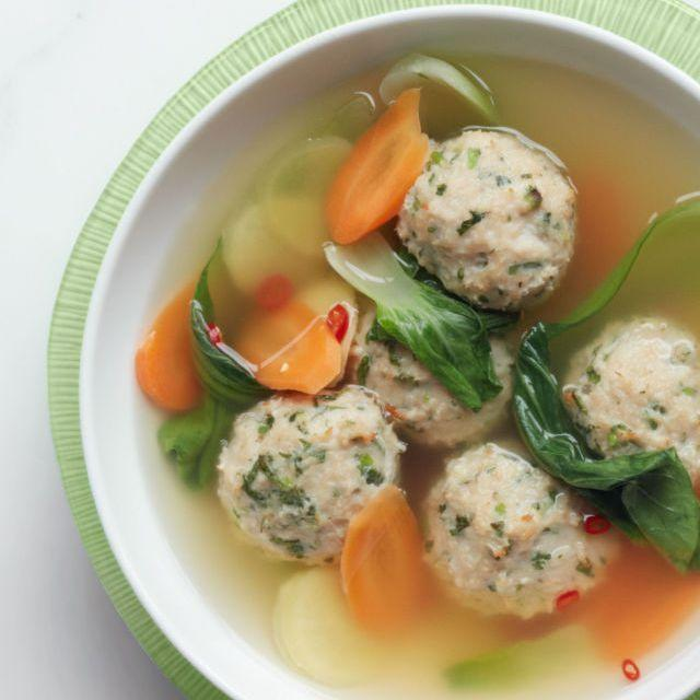 """<p>Ground chicken meatballs, floating in a ginger-flavored broth with carrots and bok choy, make for a light and healthy soup dinner.</p><p><u><em><a href=""""https://www.womansday.com/food-recipes/food-drinks/recipes/a12325/gingery-meatball-soup-bok-choy-recipe-wdy0314/"""" rel=""""nofollow noopener"""" target=""""_blank"""" data-ylk=""""slk:Get the recipe for Gingery Meatball Soup with Bok Choy."""" class=""""link rapid-noclick-resp"""">Get the recipe for Gingery Meatball Soup with Bok Choy.</a></em></u></p>"""