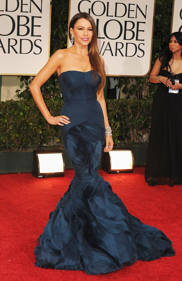 "<b>Sofia Vergara <br>Grade: A</b> <br><br>The ""Modern Family"" siren accentuated her fabulous physique in a form-fitting teal gown by Vera Wang. Loose tresses and more than $5 million worth of Harry Winston jewels completed Vergara's va-va-va voom look."