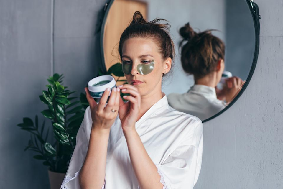 Woman studies the instructions for using eye patches