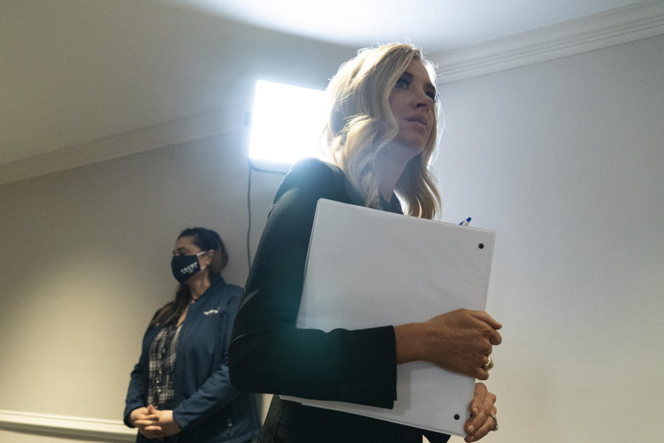 White House press secretary Kayleigh McEnany arrives for a news conference at the Republican National Committee, Monday, Nov. 9, 2020, in Washington. (AP Photo/Alex Brandon)