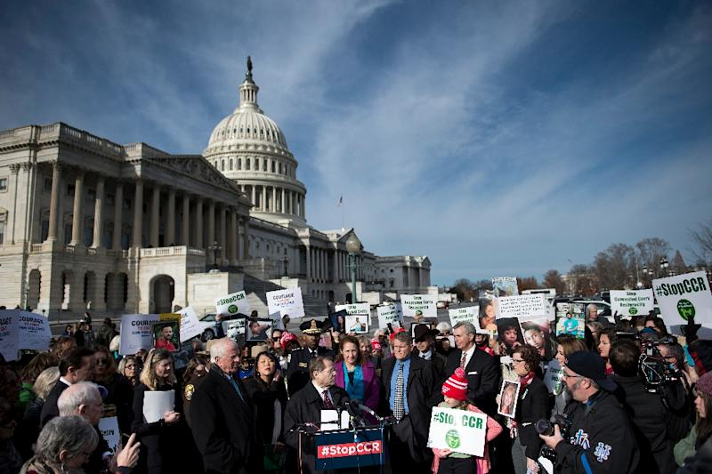 People gather on Capitol Hill opposing concealed carrying of guns on December 6, 2017 in Washington, DC, as lawmakers met and approved the measure that allows concealed firearms to move across state lines