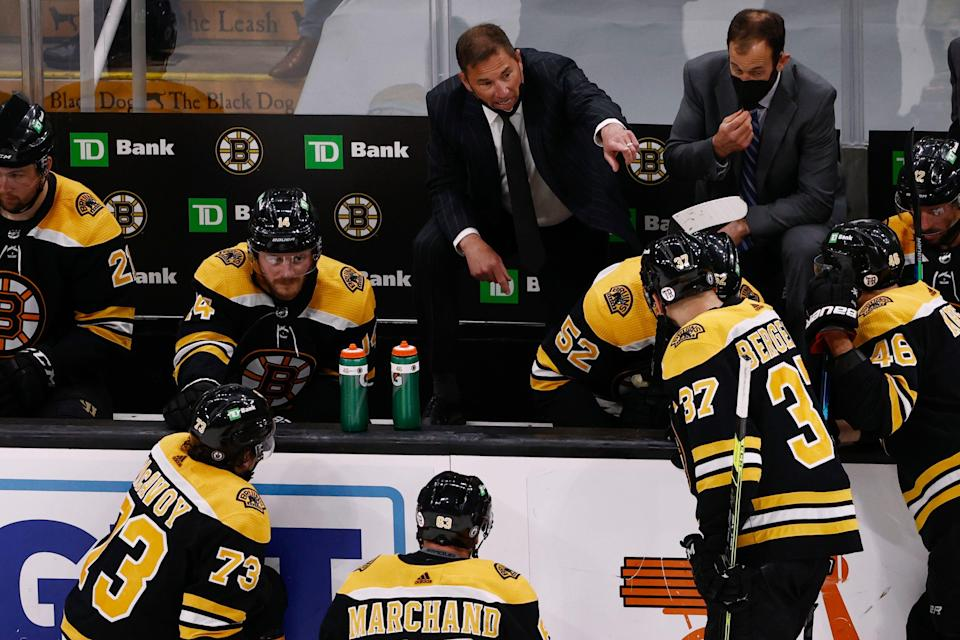Boston Bruins head coach Bruce Cassidy talks with his players during a timeout in the third period of game five of the second round of the 2021 Stanley Cup Playoffs against the New York Islanders at TD Garden.