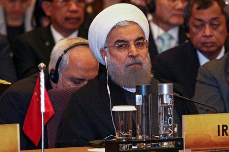 FILE PHOTO: Iran's President Hassan Rouhani attends a meeting during the Asia Cooperation Dialogue (ACD) summit at the Foreign Ministry in Bangkok, Thailand, October 10, 2016. REUTERS/Athit Perawongmetha/File Photo