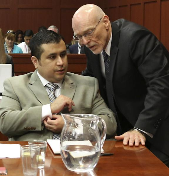 George Zimmerman, left, speaks with his attorney Don West during his trial in Seminole County circuit court in Sanford, Fla. Tuesday, June 25, 2013. Zimmerman has been charged with second-degree murder for the 2012 shooting death of Trayvon Martin. (AP Photo/Orlando Sentinel, Gary W. Green, Pool)