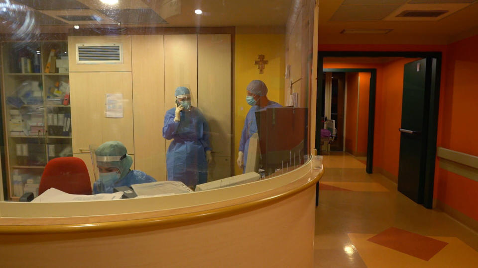 Medical personnel stand in the ward at Casalpalocco Covid 3 hospital in the outskirts of Rome, during the new year night, Friday, Jan. 1, 2021. At the Casalpalocco Covid 3 Hospital doctors and nurses barely seemed to register the new year as they tended to 100 patients struggling with serious to critical illness as a result of coronavirus infections. (AP Photo/Andrea Rosa)