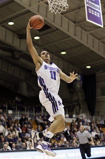 Northwestern forward Reggie Hearn goes up for a shot during the second half of an NCAA college basketball game against Texas Southern in Evanston, Ill., on Thursday, Dec. 15, 2011. Northwestern won 81-51. (AP Photo/Nam Y. Huh)