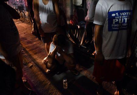 A relative of a victim cries behind the police line at the site of a drug-related shooting by unidentified men riding on motorcycles at Navotas city in metro Manila, Philippines June 19, 2017.  REUTERS/Dondi Tawatao