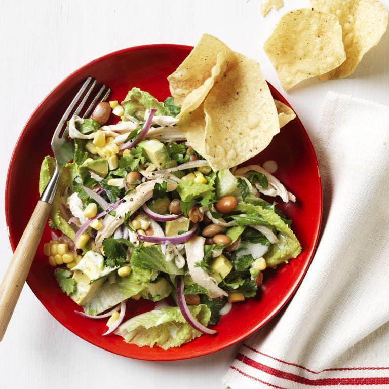 """<p>Turn any night into a fiesta with this Tex-Mex-inspired chicken salad. Add a bit of crunch with some tortilla chips — go for hint of lime if you want a little something extra. </p><p><a href=""""https://www.womansday.com/food-recipes/food-drinks/recipes/a12290/tex-mex-chicken-salad-recipe-wdy0813/"""" rel=""""nofollow noopener"""" target=""""_blank"""" data-ylk=""""slk:Get the Tex-Mex Chicken Salad recipe."""" class=""""link rapid-noclick-resp""""><em>Get the Tex-Mex Chicken Salad recipe. </em> </a></p>"""