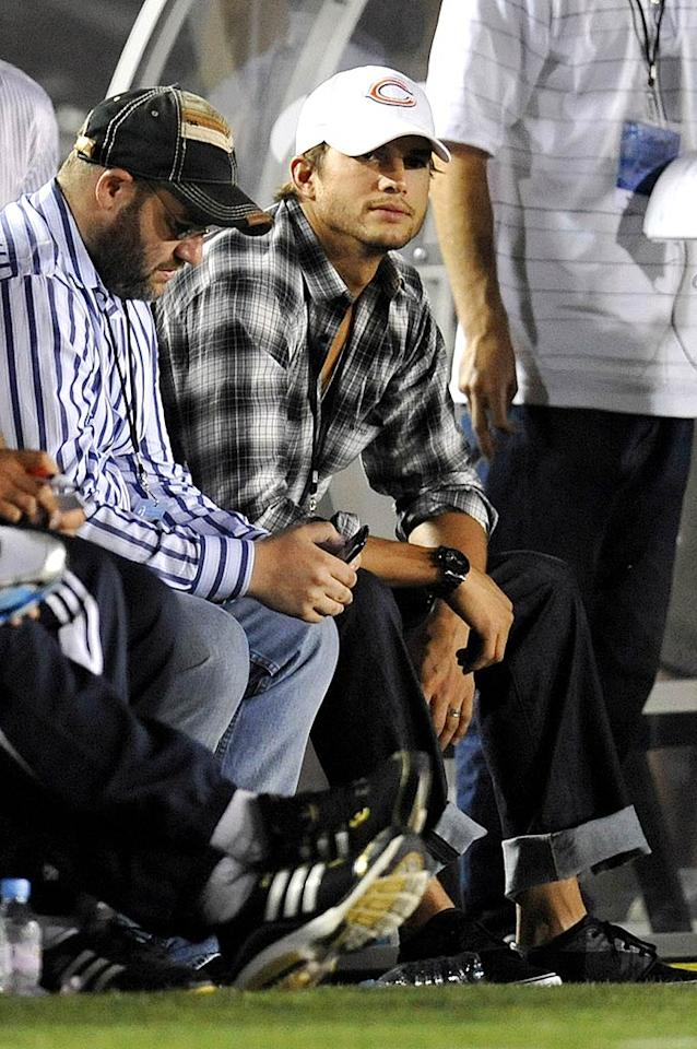 "Ashton Kutcher -- aka ""aplusk"" -- was able to watch the match from the sidelines, snapping pics and posting them to his popular Twitter account. <a href=""http://www.splashnewsonline.com"" target=""new"">Splash News</a> - July 21, 2009"
