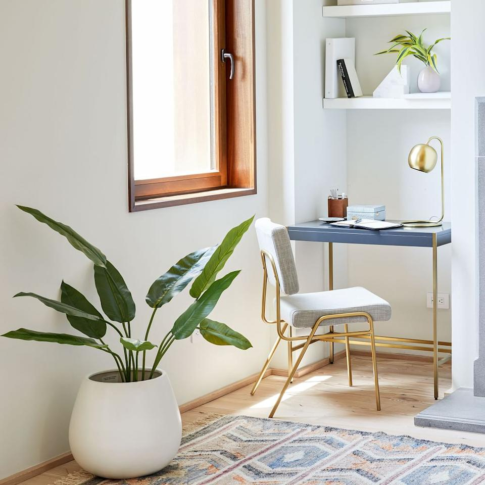 """<h3>West Elm Zane Mini Desk<br></h3> <br>Can't fit a regular-sized desk? Go for a mini desk instead — this chic little number will tuck up inside just about of your cramped space's nooks and crannies. <br><br><strong>West Elm</strong> Zane Mini Desk, $, available at <a href=""""https://go.skimresources.com/?id=30283X879131&url=https%3A%2F%2Fwww.westelm.com%2Fproducts%2Fzane-mini-desk-white-h3429%2F"""" rel=""""nofollow noopener"""" target=""""_blank"""" data-ylk=""""slk:West Elm"""" class=""""link rapid-noclick-resp"""">West Elm</a>"""