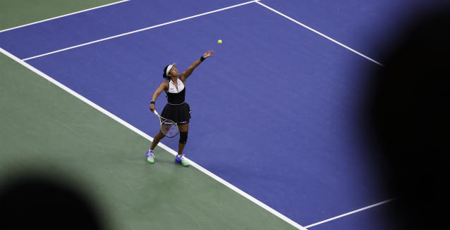 Naomi Osaka, of Japan, serves against Belinda Bencic, of Switzerland, during the fourth round of the US Open tennis championships Monday, Sept. 2, 2019, in New York. (AP Photo/Frank Franklin II)