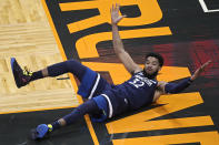 Minnesota Timberwolves center Karl-Anthony Towns reacts after a play where no foul was called during the first half of the team's NBA basketball game against the Orlando Magic, Sunday, May 9, 2021, in Orlando, Fla. (AP Photo/Phelan M. Ebenhack)