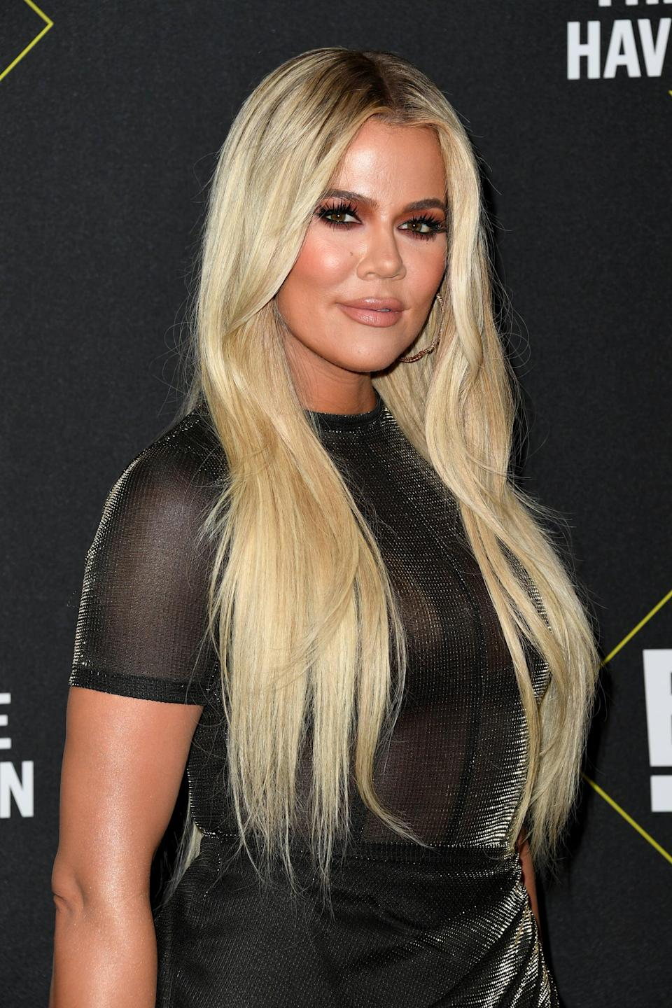 """<p>Back in 2017, the reality star and Good American founder shared a series of Snapchat videos showing herself in the process of <a href=""""https://www.etonline.com/news/211771_khloe_kardashian_gets_tattoo_honoring_her_late_father_removed_as_sister_kim_mocks_her"""" class=""""link rapid-noclick-resp"""" rel=""""nofollow noopener"""" target=""""_blank"""" data-ylk=""""slk:removing a lower-back tattoo"""">removing a lower-back tattoo</a> she got in honor of her late father, Robert Kardashian. According to <strong>ET</strong>, Kardashian got the tattoo when she was 16, and it features the word """"daddy"""" in cursive with a cross and angel wings.</p>"""