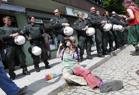 Police look at an anti-G7 protestor during a demonstration in Garmisch-Partenkirchen, southern Germany, June 6, 2015. The Group of Seven (G7) two-day summit, being held at Elmau palace near Garmisch-Partenkirchen in Bavaria, begins on Sunday. REUTERS/Michaela Rehle