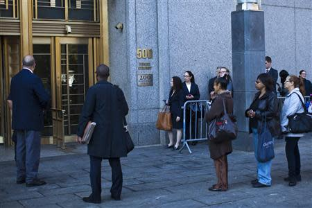 People wait in line to enter Manhattan's federal court where al-Ragye, known by the alias al-Liby, is expected for arraignment in New York