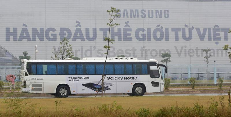 FILE PHOTO: A bus, with image of the Samsung Galaxy Note 7, transports employees on the way to work at the Samsung factory in Thai Nguyen province, north of Hanoi