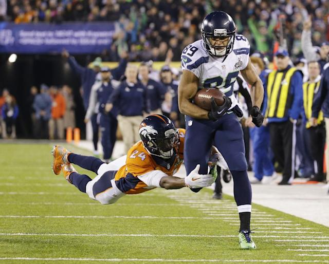 Seattle Seahawks' Doug Baldwin (89) runs from Denver Broncos' Champ Bailey (24) after making a reception during the first half of the NFL Super Bowl XLVIII football game Sunday, Feb. 2, 2014, in East Rutherford, N.J. (AP Photo/Ted S. Warren)