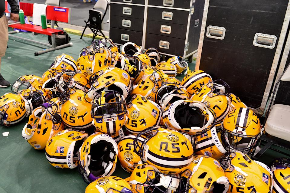 The LSU Tigers football team is now in the crosshairs of the NCAA after a report of a booster paying $180,000 to a player's father. (Photo Credit: USAT)